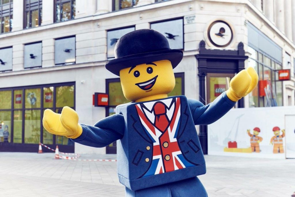 Lester right outside the LEGO Brand Retail Store in Leicester Square